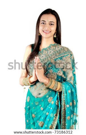 Indian girl in traditional clothing. Isolated on a white background ...