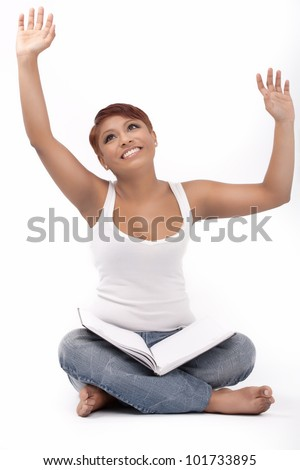Young indian girl rejoice looking at her diary