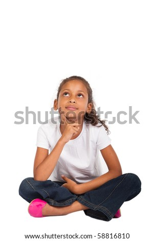 young indian girl sitting on floor daydreaming