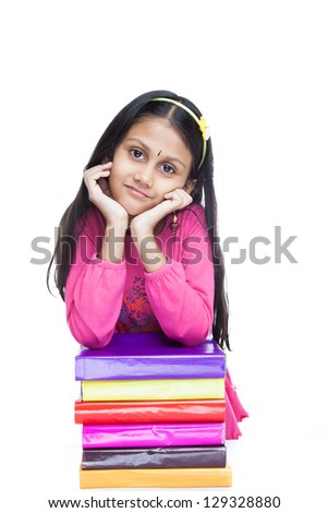 Young indian girl student holding her hands on books. Isolated on ...