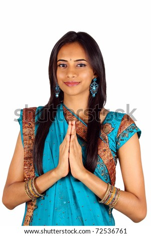 Young Indian in a namaste(greeting) pose. Isolated on a white background.