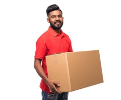 Young indian logistic delivery man in red uniform holding the box on white background