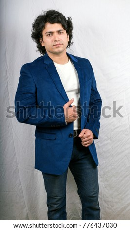 dfb8db2d1c Indian male model in blue jeans side pose Images and Stock Photos ...