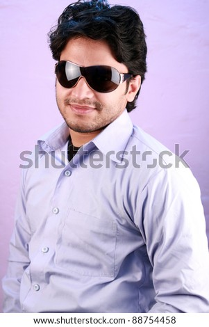 young indian male model wearing glasses close up