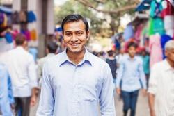 Young indian man on a street of mumbai