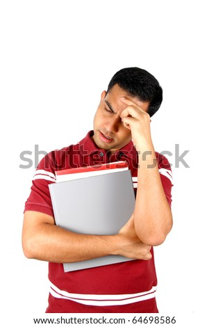 Young Indian student holding his head in stress. Isolated on a white background.