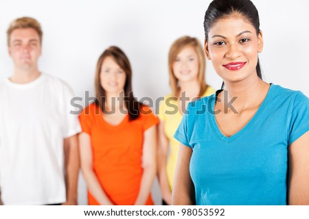 young indian woman in front of group of people