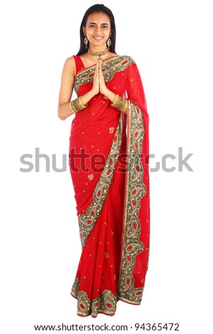 Young Indian woman in traditional clothing greeting namaste