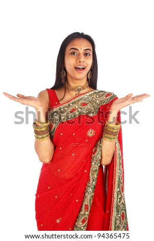 Young Indian woman in traditional clothing with a surprised expression.