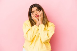 Young indian woman isolated on pink background whining and crying disconsolately.