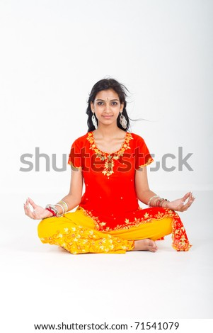 young indian woman yoga meditation in studio