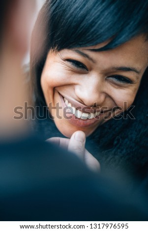 Young interracial couple love and tenderness on the street