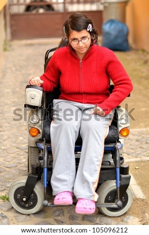 young invalid woman on the wheelchair