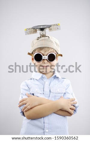 Young inventor boy wearing goggles