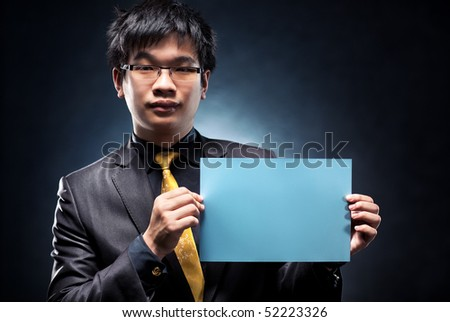 Young japan businessman with blank page. Contrast colors.