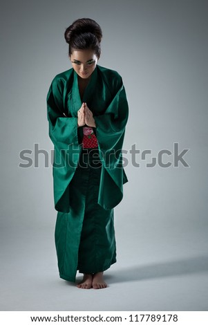 Young japanese woman bow pose.