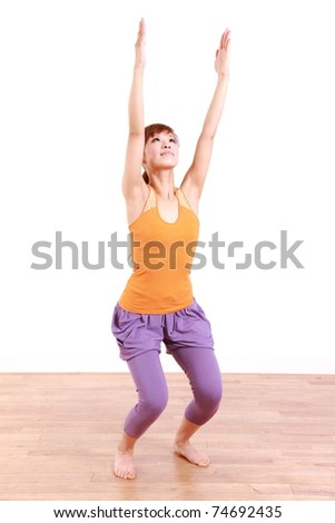 "Young Japanese Woman Doing YOGA ""chair pose"""