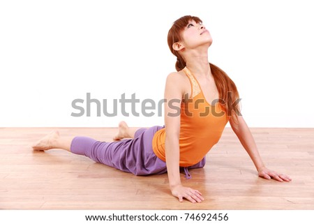 "Young Japanese Woman Doing YOGA ""cobra pose"""
