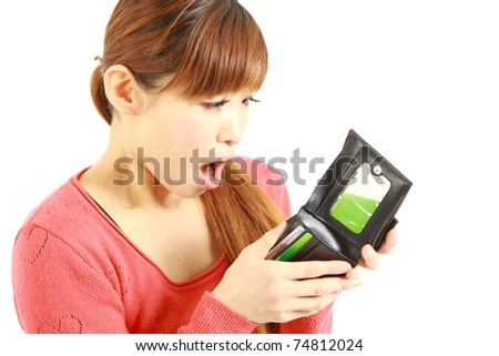 Young Japanese woman looking at her empty wallet