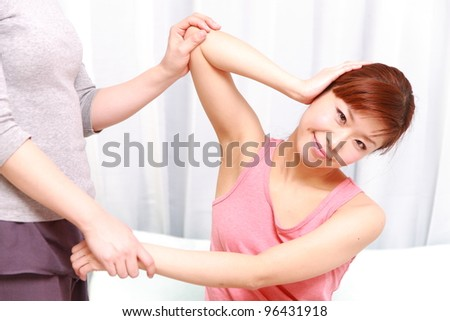 young Japanese woman receiving thai massage