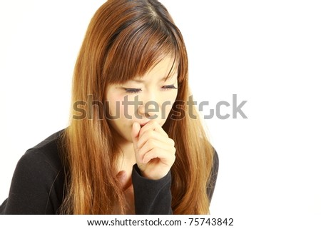 Young Japanese woman suffering with a bad cough