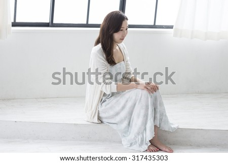 Young Japanese woman waking up   #317435303