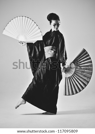 Young japanese woman with fans. Black and white film style colors.