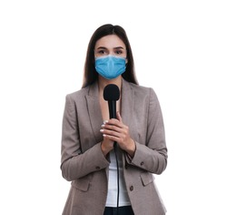 Young journalist with microphone wearing medical mask on white background. Virus protection