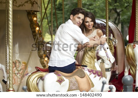 Young joyful couple visiting an attractions park