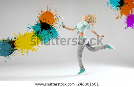 Young joyful woman with a paint roll