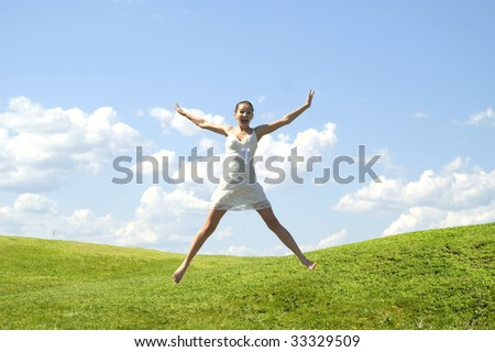 young jumping woman against nature background