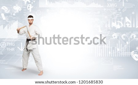 Young karate trainer doing karate tricks on the top of a metropolitan city #1201685830