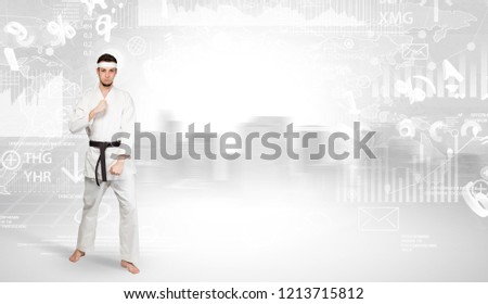 Young karate trainer doing karate tricks on the top of a metropolitan city #1213715812