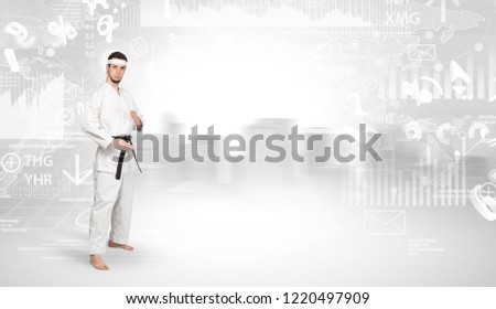 Young karate trainer doing karate tricks on the top of a metropolitan city #1220497909