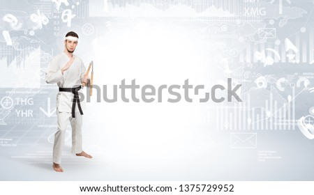 Young karate trainer doing karate tricks on the top of a metropolitan city #1375729952