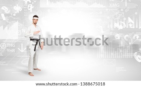Young karate trainer doing karate tricks on the top of a metropolitan city #1388675018