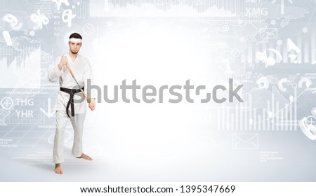 Young karate trainer doing karate tricks on the top of a metropolitan city #1395347669