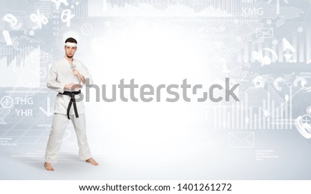 Young karate trainer doing karate tricks on the top of a metropolitan city #1401261272