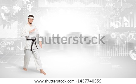 Young karate trainer doing karate tricks on the top of a metropolitan city #1437740555