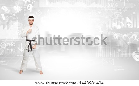 Young karate trainer doing karate tricks on the top of a metropolitan city #1443981404