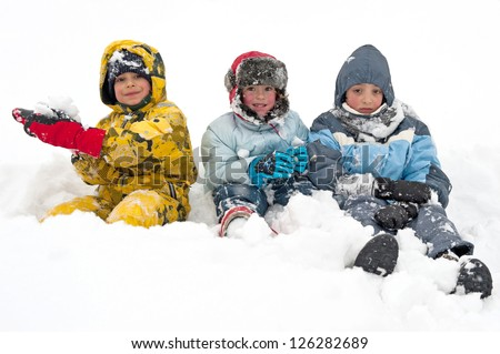 Young kids playing in the snow.