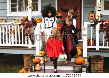 Young kids trick or treating during Halloween