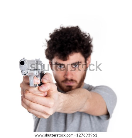 Young killer pointing a gun over white background.