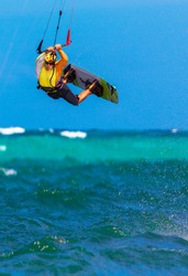 young  kite surfer on tropical sea background Extreme Sport Kite surfing