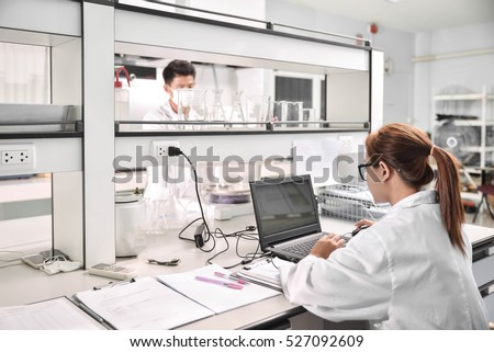 Young laboratory assistant prepare instrument for chemical lab experiment in Lab