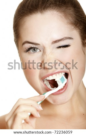 young lady brushing her teeth, isolated on white