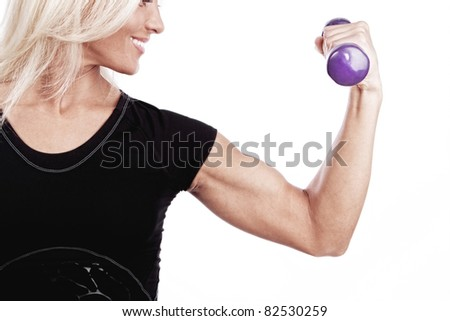 Young lady doing workout with weights