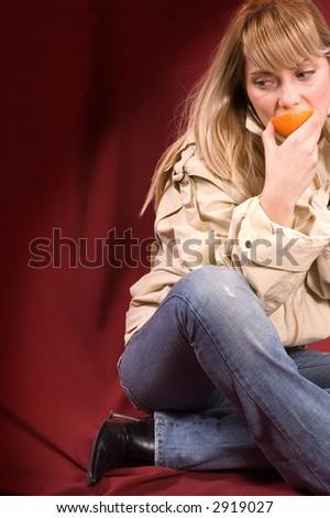 Young lady holding orange fruit, healthy concept