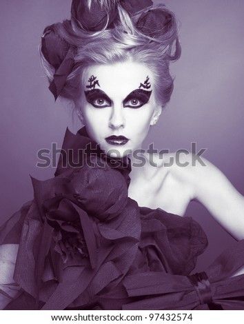 Young lady in creative image and with combs.