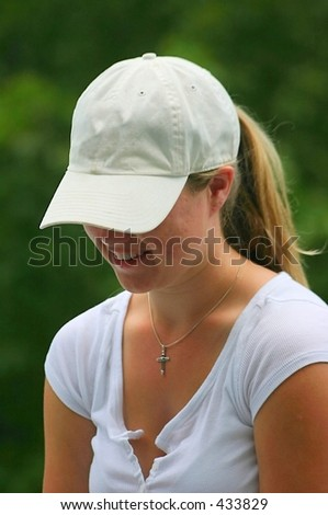 young lady in white baseball hat